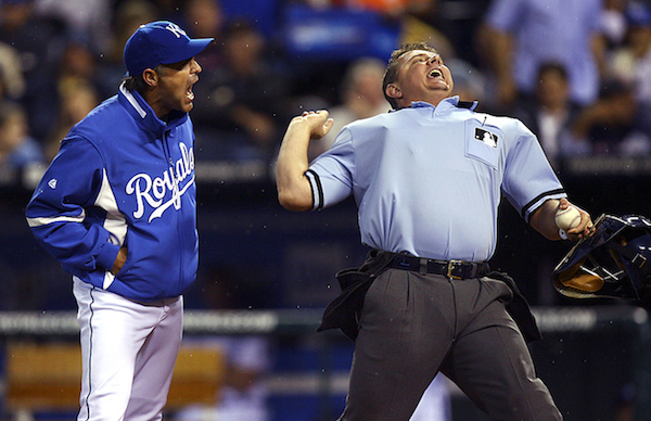 Umpire Greg Gibson, Manager Trey Hillman, AP Photo/Ed Zurga